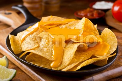 Nachos with Cheese Sauce Stock Photo