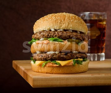 Double Cheeseburger and Soda Stock Photo