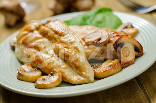 Grilled chicken breast with sauteed mushrooms.